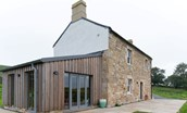 Lowtown Cottage - exterior with traditional Northumbrian brickwork and sun room extension