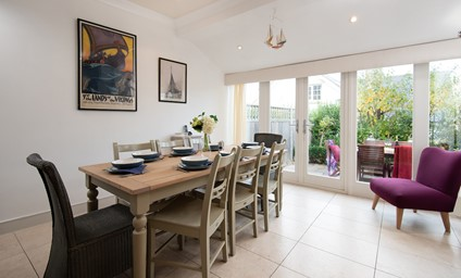 The bright open plan dining room is a fantastic spot for socialising and relaxed suppers.