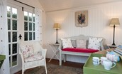 The Cottage - inside the summerhouse - ideal for afternoon tea!