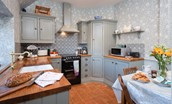 The Cottage - kitchen with William Morris wallpaper