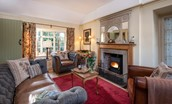 The Cottage - cosy sitting room with Harris Tweed and wood burner
