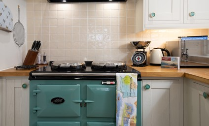 The electric AGA in pistachio adds a cosy touch - perfect for rustling up a home cooked casserole.