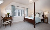 South Lodge - bedroom two with four poster bed