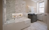 Glenburnie - bathroom with bath and shower over