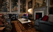 The Earl & Countess - sitting room with dramatic wall panels and soft evening lighting