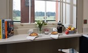 The Sculleries - kitchen breakfast bar with views over the parklands