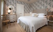 West Lodge - bedroom with wallpaper from designer Angie Lewin