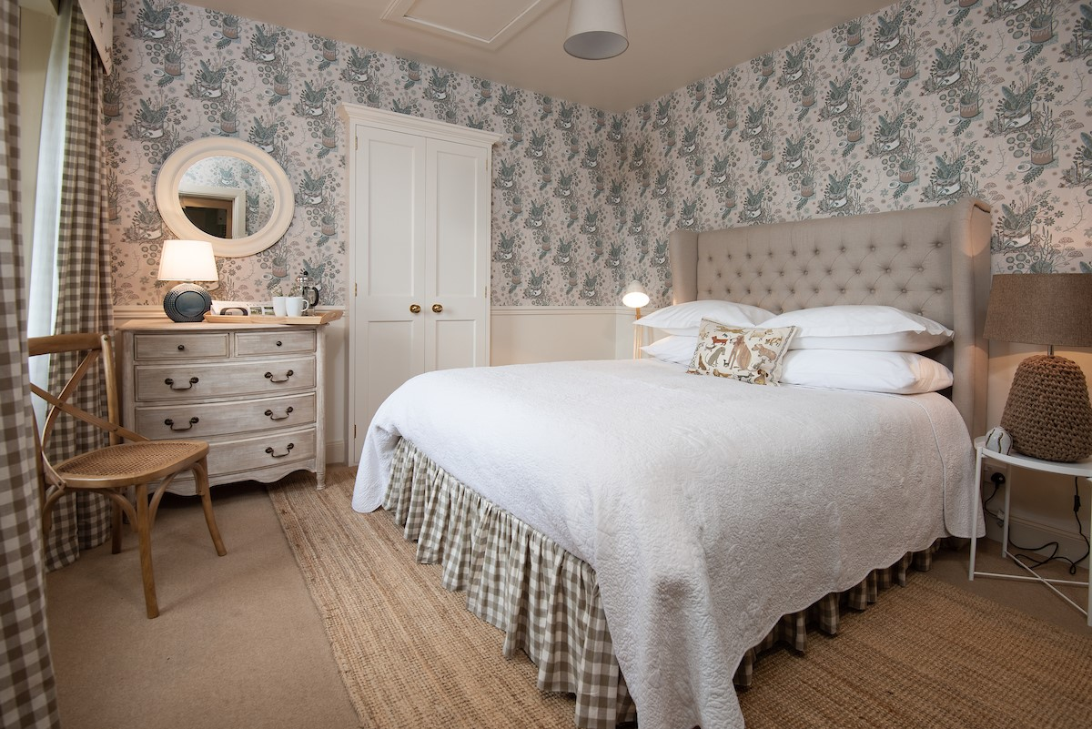 This is a cottage for peaceful relaxation. My favourite part of the décor is the 'Nature's Table' wallpaper by designer Angie Lewin  and fabrics by artist Domenica More-Gordon.