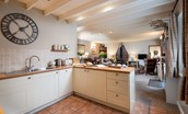 Saddler Cottage - kitchen with view of lounge
