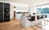 East Bay Beach House  -  kitchen breakfast bar and fridge freezer