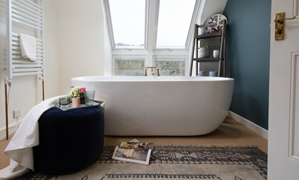 Spend lazy mornings and long evenings relaxing in the freestanding bath with splendid views towards Faldonside Loch and its resident love bird swans.