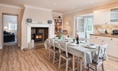Berryburn Cottage - dining area with wood burner