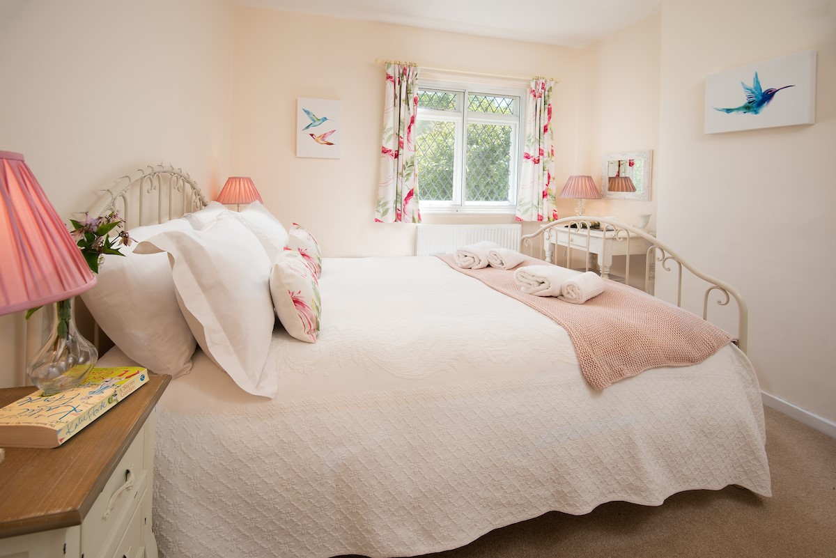 Waking to the uplifting sound of bird song in the pretty cottage style bedrooms.