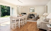 Open plan dining area with snug and large wood burner