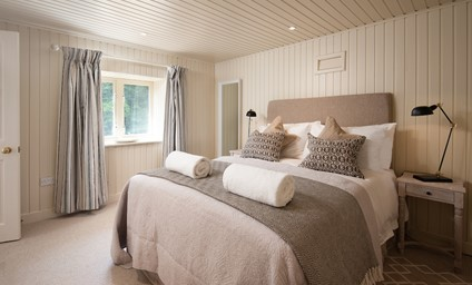The wood-clad bedroom has the feel of a cosy cabin in the forest - tranquil inside and out.