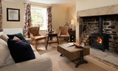 Aydon Castle Cottage - sitting room with wood burning stove