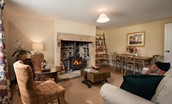 Aydon Castle Cottage - sitting room with dining space