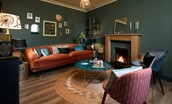 Mulberry Cottage - sitting room with open fire and large double sofa