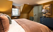 Bedroom one - with rich ochre walls