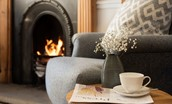 Tweedside - a cosy armchair in front of an open fire
