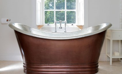 The statement copper bath is perfect for long, indulgent soaks.