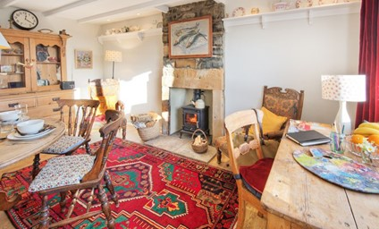 The collection of original artworks and delightfully quirky touches throughout the cottage.
