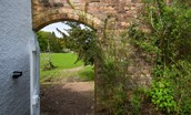 Gardener's Cottage, Elliston - archway from the front garden