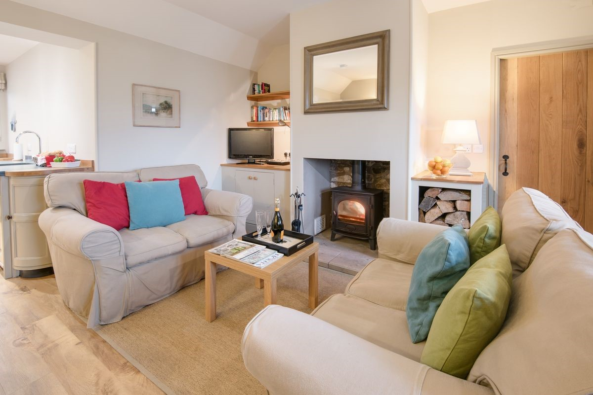 Barley Hill Cottage - fireside with door to bedroom two