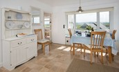 Beachcomber Cottage - dining area with dresser