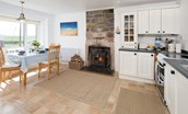Beachcomber Cottage - kitchen with wood burning stove