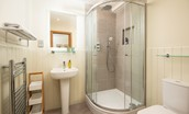 Old Granary House - en suite of bedroom one featuring a corner shower with rainforest head and separate mixer
