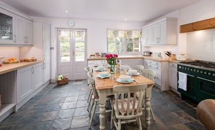 The charming country kitchen with large range cooker is a lovely spot for the family to gather.