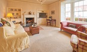 Border Cottage - sitting room with fire