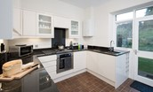 Chaffinch Cottage - kitchen with door to rear garden