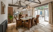 Coach House - dining area, kitchen & door to courtyard