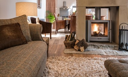 The double sided log burner that radiates a magical warmth throughout the living area.