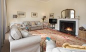Coachman's Cottage - sitting room with fire