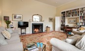 Coachman's Cottage - sitting room with library & fire