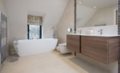 Coledale Stables - bedroom three en suite bathroom with bath