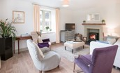 Crailing Cottage - sitting room with wood burning stove