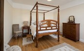 Dipper Cottage - bedroom one with four poster bed