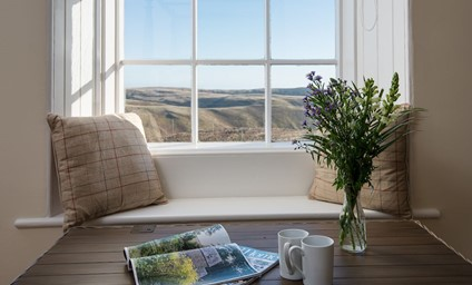 The window seat is the perfect place to enjoy the first coffee of the day overlooking the Northumberland National Park.