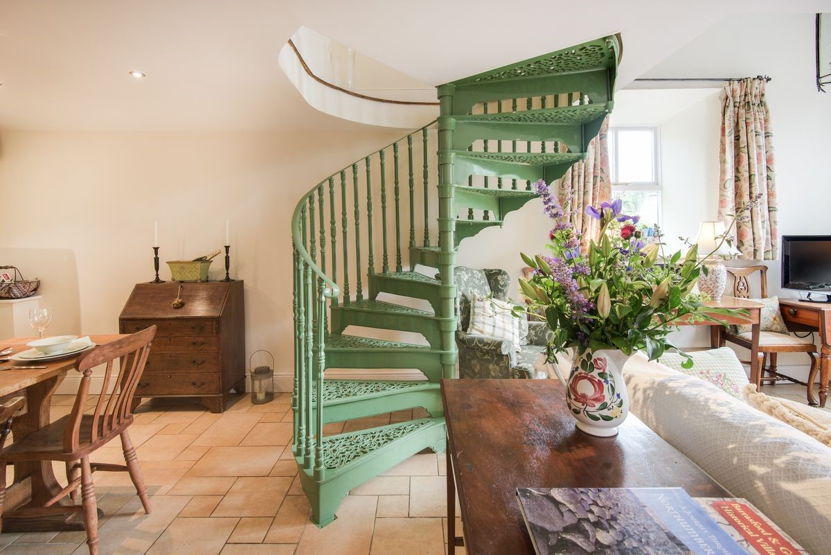 The green spiral staircase is a statement piece which adds such character and charm to the living space.