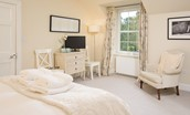 Crailing Coach House - bedroom one with garden views