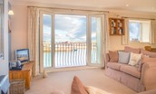 Farne View - sitting room with Juliet balcony