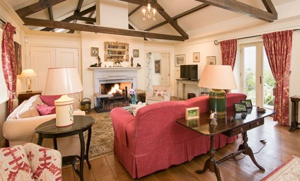 The original exposed beams, working fireplaces, unusual antique items and interesting artwork and objets d'art added by the owners add such charm and character.