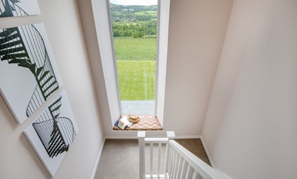 The fantastic feature window in the hallway beautifully frames the view and extends all the way down to the lower ground floor.