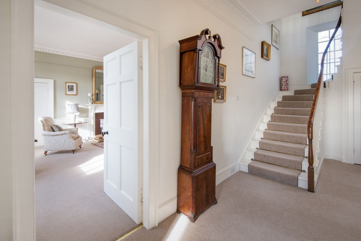 Halliburton - entrance hall with drawing room access & staircase
