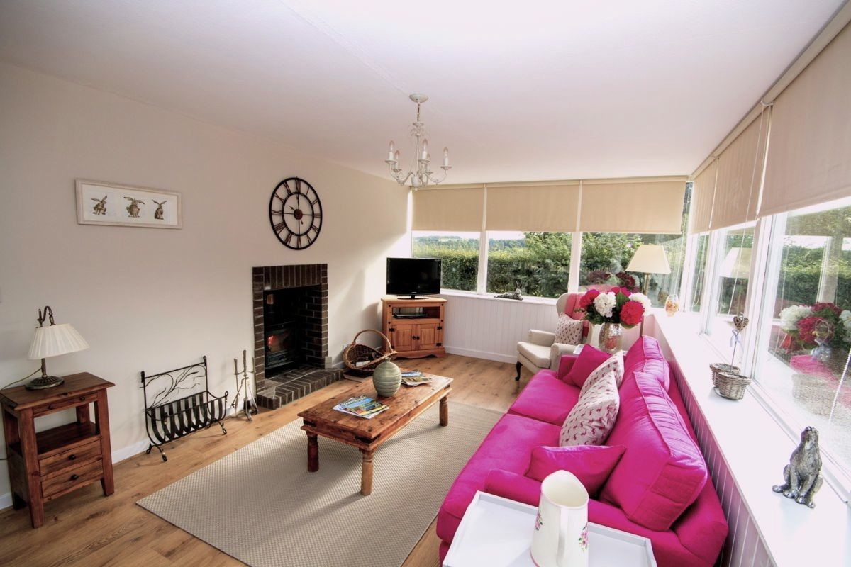 Kersmains Farm Cottage - sitting room/conservatory with fire