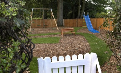 The large garden is fully-enclosed so little ones can play safely and enjoy the charming, fully-equipped Wendy house, swings, slide and sand pit.